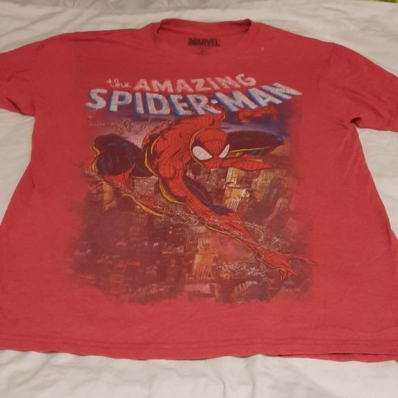 many shirts, mostly marvel